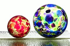 Big & Little (Karen_Chappell) Tags: two orb sphere round ball circle glass white blue orange yellow green stilllife 2 purple colourful multicoloured colours colour color