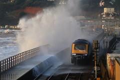 Dawlish storm 5 (matt.clark25) Tags: storm sea seas dawlish devon winter foam spray gale weather hazard transport train railway track mainline sunlit tide marine