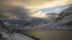 mountain's silver and sea's gold (lunaryuna) Tags: selfjorden norway northernnorway lofoten lofotenislands lofotenarchipelago bridge fjord mountainrange lofotenwall winter season seasonalbeauty sky clouds lightmood thelightfantastic panoramicviews landscape seascape shoreline lunaryuna