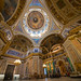 Visitors dwarfed by Saint Isaac's Cathedral interior. The dome rises 101m and it is plated in gold (Russia)