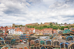 Harbour, Whitby (jack cousin) Tags: trees sea people cloud building cars church water port buildings river landscape harbor town nikon harbour seagull gull hill ruin scape lobsterpots whitbyabbey crabpots d610 riveresk on1photos