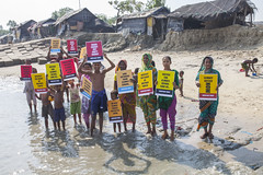 Sea level rising : Kutubdia is now vanishing island (auniket prantor) Tags: life blue sea sky people house storm man weather children poster island rising march justice women asia waves outdoor near refugee indian south report victim under banner protest dry social erosion soil human together level impact area gathering summit land editorial change inside cyclones dried migration lose vanishing issue bangladesh interest climate crisis bazar coxs placard stronger global vulnerable sealevel on bangladeshi subcontinent inhabitant affect intrusion 2015 salinity surges kutubdia