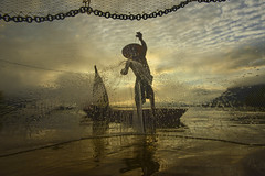 Fisherman nets in sunrise (SaravutWhanset) Tags: china travel sunset summer cloud sun sunlight mist fish river indonesia asian thailand fisherman asia action smoke thai laos jouner