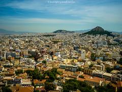 Athens sparkles. (Shutterbytes by Michele Hamilton) Tags: houses reflection architecture athens sparkle parthenon greece acropolis glint cityview urbansprawl may2013
