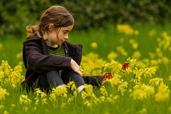 Amélie & the Spring flowers. (kevaruka) Tags: amélie hardwickhall derbyshire countryside england daughter portrait colour colours nationaltrust spring flowers green yellow red composition flickr frontpage thephotographyblog explore stock canon canon7d canonef100400f4556l telephoto 400mm canoneos7d bokeh dof depth blur field favourite family