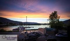 Sundown in Osoyoos (ScopiePhotography) Tags: bc osoyoos sunset water trees marina boats dock mountains hills peace calm purple yellows beautiful