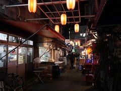 Under the Lights (CentipedeCarpet) Tags: japan panasonic gx8 micro four thirds tokyo night lights lanterns glow city dark 東京 赤羽 日本 夜 夜景 提灯 akabane beautiful worn old urbex urban unlimited photos
