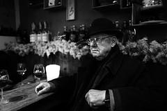 Dante the singer (Giulio Magnifico) Tags: friuli man hat glasses streetphotography bw pepatadicorte singer portrait osteria wine leica christmas leicaq wood 28mm blackwhite udine old