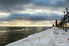 Winter Lighthouse Perspective (matthewkaz) Tags: grandhaven pier lighthouse grandhavenlighthouse lakemichigan lake water greatlakes ice snow winter sky clouds sunset catwalk michigan 2016