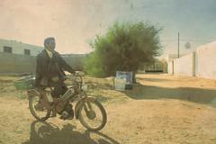 2890 (adnogstreets) Tags: midoum scooter soleil sun vélo bike tractor tracteur charette école school market marché moon lune desert hotel hostel