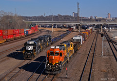 NS and BNSF Trains in Kansas City, KS (Grant Goertzen) Tags: bnsf atsf santa fe railroad railway locomotive train trains kansas city ns norfolk southern western conrail penn central sal seaboard airline up union pacific emd ge power transfer freight manifest west westbound yard