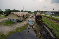 From the Rooftops (ajketh) Tags: freight train railroad chadbourn nc north carolina cala southern shortline local rj corman emd sw9 87 gp30 2613 gp18 958 gp38 midatlantic railway yard station depot hazy july summer evening scrap saved 2005 wclr waccamaw coast line