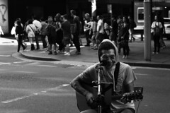 Street Performer, Sydney (Trent Crawford) Tags: blackandwhite monocrome street face deformed happy busker performer musician guitar singer sing music