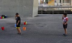 people in bilbao (maximorgana) Tags: street people playing colour art children graffiti kid bucket couple crying bilbao paseo promenade ria barandilla nervion colorinchi