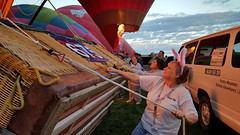 As the balloon rises, the basket is pulled upright