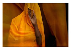the yellow hiding place (handheld-films) Tags: travel portrait people woman india girl smile smiling yellow female happy women head indian happiness hidden portraiture hiding sari isolated rajasthan fabrics