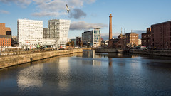 #Liverpool docks (Joe Dunckley) Tags: canningdock docklands eastlondon england lancashire liverpool liverpooldocks london merseyside rivermersey uk apartmentbuilding architecture bluesky building chimney dock harbour industrial industry pumphouse river sky sunny water
