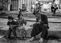 Dinner (Saman A. Ali) Tags: street streetphotography stphotografia streetlife blackwhite blackandwhite bw people documentary dailylife outdoor socialdocumentary monochrome children man old