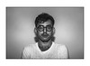 Mad. (nickobaills) Tags: selfportrait mad madness exposed glasses man neard blackandwhite grey gray grayscale noir noiretblanc