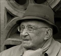 Portrait (Natali Antonovich) Tags: sweetbrussels brussels portrait grandplace stare reverie hat hats glasses lifestyle monochrome belgium belgique belgie tradition