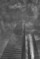Swirling around the glass tower (Modesto Vega) Tags: architect architecture arquitecto arquitectura blackwhite blancoynegro cbta cloud cuatrotorresbusinessarea césarpelli d600 fullframe madrid monochrome monocromo nikon nikond600 peicobbfreed rascacielos skyscraper spacetower swirl torreespacio torredecristal towerofglass