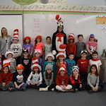 Students pose with elementary students on Dr. Seuss day