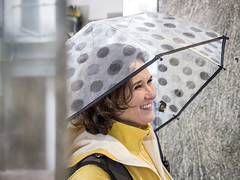 Petra, Amsterdam 2017: Gorgeous smile (mdiepraam) Tags: petra amsterdam 2017 maxeuweplein portrait pretty beautiful dutch fortysomething brunette woman coat umbrella