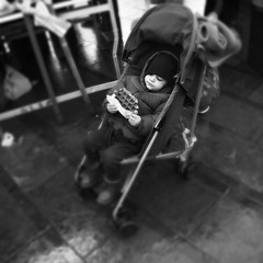 A Belgian Story (Ren-s) Tags: noir blanc black white noiretblanc nb blackandwhite bw people kid enfant gauffre waffle belgianwaffle belgique belgium bruxelles brussels ixelles flagey place market street rue photographiederue streetphotography photography bokeh europe young child eating mange winter hiver exterieur marché food nourriture