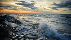 Cold Sunset (mswan777) Tags: waves cold shore ice frozen evening sunset glow sky cloud blocks wall lake michigan nikon d5100 sigma 1020mm scenic landscape seascape winter water