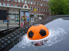 Oops... (P Villerius) Tags: orange holland broken window netherlands girl car ball poster football rotterdam funny soccer 2006 oops wk worldcup oranje bal