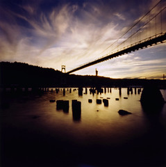 St Johns Bridge, 30 seconds (Zeb Andrews) Tags: longexposure sunset color beautiful architecture clouds oregon spectacular square portland amazing cool nice bridges stjohns pinhole pacificnorthwest zero2000 willametteriver zeroimage stjohnsbridge iloveit pinscape myfavouriteplacesintheworld zero66 bluemooncamera historicbridges zebandrews zebandrewsphotography
