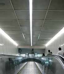 Lazy Man's Stairs (Battling Apathy) Tags: canada vancouver publictransit britishcolumbia escalator 2006 pacificnorthwest linearlove skytrain translink intransit burrardstation vanishingpoints wufiii iwishidbeen18inchesfartherleftsothescenewouldbesymmetrical