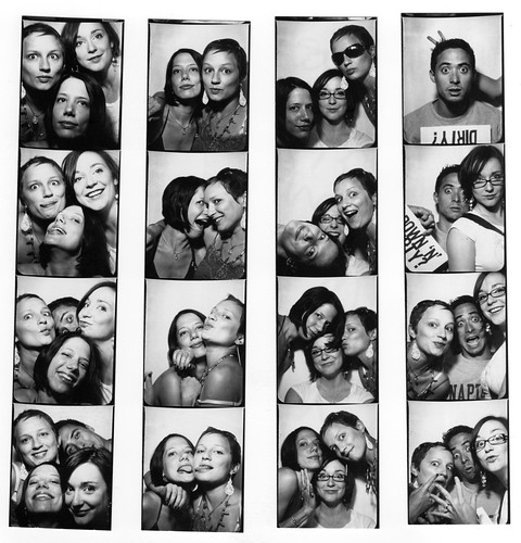 4 in a photo booth