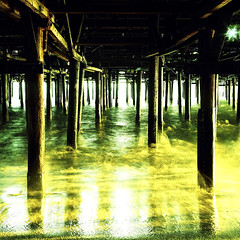 sunset under the pier. santa monica, ca.  2006. (eyetwist) Tags: ocean longexposure 120 6x6 water mediumformat square pier xpro crossprocessed waves fuji cross santamonica crossprocess 123 landmark 2006 ishootfilm pacificocean socal wharf pilings process santamonicapier fujichrome kiev processed sixbysix kiev60 top20xpro underthepier c41 rhp longex betterlivingthroughchemistry santamonicabay cotcpersonalfavorite eyetwist ishootfuji smpier dramaticcolor russianmediumformat 6x6x6 3best adoublefave underthesantamonicapier contactforstockusage thisimagemaybeavailableforlicensecontactformoreinfo