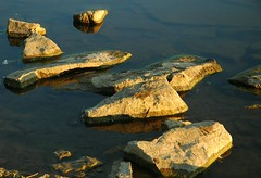 Lake Rocks (ricko) Tags: sunlight lake water reflections rocks kansas shawneemissionpark 5hits
