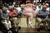 Ole TwinkleToes (Box of Light) Tags: pink motion senior beauty ruffles drag blurry lowlight ballerina funny audience grain laugh perform pageant tutu elizabethcity beautypageant seniorcenter twinkletoes boxoflight womanless bestassignmentever theguywiththenipples badqualityinthis