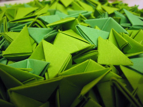 Bucket of green modular origami bits