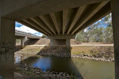 Under the Hume Higway (yewenyi) Tags: road water creek highway rocks australia victoria m31 vic underneath aus murrayriver oceania wodonga auspctagged humehighway northeastvictoria highway31 pc3689 wineandhighcountry national31 pc3690 wodongaruralcity wodongacitycouncil cityofwodonga murrayrivervalley