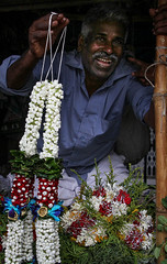 The streets of Mumbai (Leaning Ladder) Tags: india leaningladder mumbai bombay flowers faces dadarflowermarket canon 7d