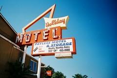 Multitasking (jfpj) Tags: film sign toycamera motel idaho signage vivitar plasticcamera caldwell motelsign vintagesign trashcam 10faves vivitarultrawideandslim