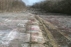 (Pheral Lamb) Tags: film fuji doubleexposure ground multipleexposure centralia asphalt expiredfilm 28105 highway61 nikonf4 superia800 minefire dividinglines route61 warpedearth medianstrip abandonedhighway graffitiroad graffitihighway
