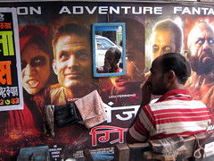 'Face-off' (Rajib Singha) Tags: street travel portrait people india interestingness kolkata westbengal flickriver canonpowershots90