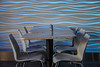 Empty Table in Café, National Aquarium in Baltimore (dckellyphoto) Tags: nationalaquariuminbaltimore nationalaquarium baltimore 2016 december interior table wave light lights chairs modern abstract design inside stilllifephotography stilllife blue reflect reflection shiny smooth empty vacant plastic water bluestblue salt pepper shaker curve curves curved undulating baltimoremaryland maryland blueazul