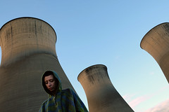 Overpowering. (Amethyst.Addams) Tags: coolingtower powerstation architecture buildings sky portrait selfportrait portraiture people fashion outdoors adventure explore contemporary cathartic colour cinematic creative expressive exposure experimental raw atmosphere naturallight nature light fujifilm fineart photography photoaday 365 dreamy dramatic modelographer conceptual surreal self woman landscape high