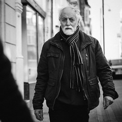 Mr. Unknown (Howie Mudge LRPS) Tags: man male aged old person beard jacket walk walking outside outdoors travel travelling traveler candid casual portrait photography photographer shops buildings architecture windows road car lamppost blackandwhite blackwhite mono monochrome monochromatic vsco ilford hp5 aberystwyth ceredigion wales cymru uk scarf street streetphotography streetlife panasonic lumix microfourthirds micro43 micro43mountlenses intense serious star staring eyecontact