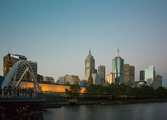 Melbourne at dusk (Marian Pollock) Tags: melbourne yarra skyline sunset yarrariver reflections bridge skyscrapers people fivex trees australia victoria city water river spires nikon dusk footbridge