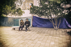 North Korean Couple On A Bench (Baron Reznik) Tags: portrait horizontal model streetphotography streetscene korea ethnic everydaylife northkorea chosun dprk colorimage songdo kaesong 모델 조선 democraticpeoplesrepublicofkorea 북한 개성 조선민주주의인민공화국 chosŏnminjujuŭiinminkonghwaguk northhwanghaeprovince canon28300mmf3556lisusm 황해북도 kaesŏng 개성특급시 開城特級市 hwanghaipukto 黃海北道