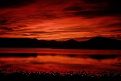 Red And Black Loch Lomond (Clydebank Photography) Tags: sunset sky mountain lake mountains tree water clouds landscape scotland loch trossachs lochlomond milarrochybay stevenmcdougall fujinonxf27mm fujifilmxt1 stevenmcdougallphotographer