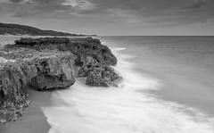 BW Florida Limestone Cliffs (tshabazzphotography) Tags: longexposure shells nature clouds sunrise moss sand arch footprints beachlife atlantic dslr canondslr atlanticocean photography101 crashingwaves naturelovers longshutterspeed beachlovers earlybird pepples flickrfan canonpics limestonerocks limestonecliffs jupiterflorida beachphotography landscapephotos blowingrockpreserve sunriselovers smoothwaves coralcovebeach photographyislife igers landscapephotographers canonphotogrpahy hopesound