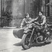 Two Chinese women riding a motorcycle with sidecar
